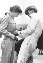 Doreen Evans with brother K D Evans(?) Brooklands paddock - Maybe 1935 BRDC 500.